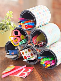 Wrap several tool cans in coordinating patterned papers and stack in a pyramid shape. Use a hot glue gun to attach the cans to each other. When completely dry, set on a desktop or worktable for easy tool access. Use the same idea with gallon cans to store larger items.