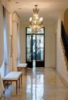 iron door and stair rail @Christine Kolek www.christinekolek.com #Interiors #Entryways #ChristineKolek