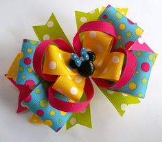 Bright and colorful Minnie Boutique handmade hair bow.  Perfect for a visit to Disney.