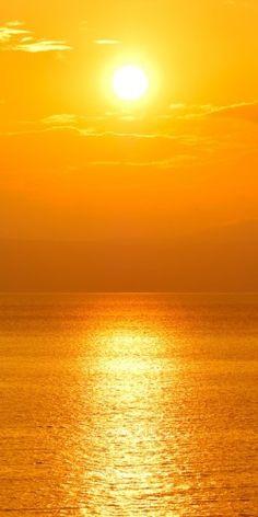 Sun setting over the ocean.