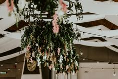 we decorated  the wedding hall with flower chandeliers.