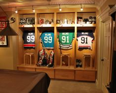 Use track lighting with LEDs to highlight Family Room Sports Memorabilia -UV free- Luv the sport lockers Hockey Man Cave, Hockey Room, Hockey Decor, Sports Man Cave, Sports Memorabilia Display, Terrazas Chill Out, Quotes Girlfriend, Sports Locker, Sports Office