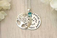 A personal favourite from my Etsy shop https://www.etsy.com/listing/529453399/birthstone-family-tree-necklace-name