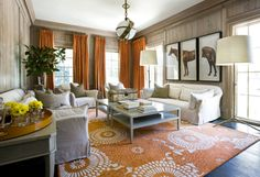 Orange, taupe, and a great rug.