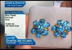 Blue topaz flower earrings. 15 carats of glowing blue topaz form lovely flowers in this pair of 14k yellow gold earrings.
