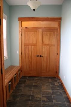 Blog post on mixing natural wood trim with white trim. I like the floor and blue walls
