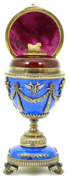RUSSIAN GUILLOCHE & SILVER FOOTED EGG w/ SURPRISE Imperial eagle finial. Silver & bronze accent mounts throughout egg. Stamped to base with the 88 mark for Russian silver. Bears the Faberge mark to base accented with ruby's and sapphires.  http://www.eliteauction.com/catalogues/122014/images/19_1.jpg