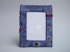 Metal picture frame covered with patchwork dark denim made of polymer clay. $11.50, via Etsy.