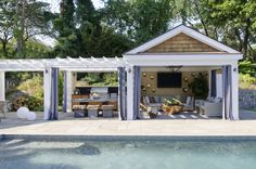 Luxurious pool cabana is partially concealed behind gray grommet curtains framing taupe shiplap walls holding a flat panel television flanked by gold Pool House Designs, Backyard Patio Designs, Backyard Landscaping, Landscaping Ideas, Backyard Ideas, Pool Cabana, Backyard Cabana, Pool Gazebo, Desert Backyard