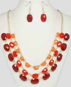 Red Crystal Multi-layer Gold Bib 3 Layered Necklace Set & Matching Earrings by Jewelry Nexus Jewelry Nexus,http://www.amazon.com/dp/B00GN7YKTQ/ref=cm_sw_r_pi_dp_W.D0sb1YAQ193XN6