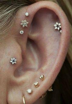Cute Multiple Flower Ear Piercing Jewelry Ideas for Women . How To Balance Ear P… Cute Multiple Flower Ear Piercing Jewelry Ideas for Women . How To Balance Ear P… Related posts:Ear Piercing Safety. Helix Piercings, Piercing Oreille Cartilage, Piercing Anti Helix, Piercings Ideas, Ear Piercing Studs, Cool Ear Piercings, Ear Peircings, Smiley Piercing, Multiple Ear Piercings