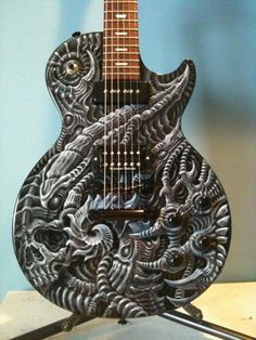 Sweet guitar, faintly reminds me of H.R Giger's work. That fret board needs some oil though