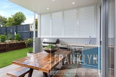 White Aluminium Shutters by Franklyn have transformed this outdoor entertaining area.