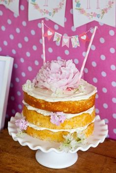 Lovely layer cake at a wild flower birthday party. We are loving this cake for a springtime celebration.