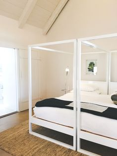 Modern, minimalist white frame beds for a simple, contemporary bedroom. P H O T O: Miss Moss Minimalist Home Decor, Minimalist Bathroom, Modern Minimalist, Twin Canopy Bed, Victorian Bath, Basement Guest Rooms, Miss Moss, Relaxation Room, White Rooms