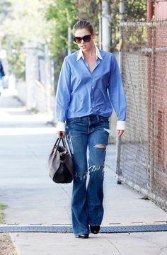 Ali Larter wore her wide-leg distressed jeans with a preppy YSL blouse and structured Nina Ricci bag // #Denim
