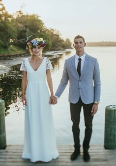 boho bride style with beaded sleeves and floral crown, groom in grey and skinny tie