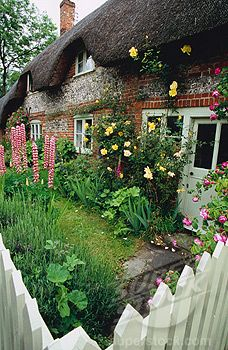 """""""Thatched brick and flint cottage..."""""""