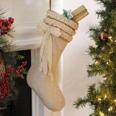 Despite not having much color, Kirkland's Burlap Ruffle Christmas Stocking is a gorgeous addition to your mantle for Christmas! Its ruffle and stylized bow this stocking is the epitome of elegant!