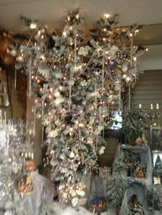 Upside-down Christmas tree hanging like a chandelier ! Love it ...