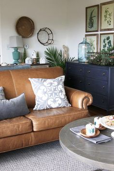 Christmas Tour 2016 2019 Love this pillow especially paired with natural and more casual surroundings (leather plants baskets navys browns & greens) The Inspired Room 2016 The post Christmas Tour 2016 2019 appeared first on Furniture ideas. Navy Living Rooms, Simple Living Room, Living Room Green, New Living Room, Living Room Sofa, Living Room Furniture, Brown Leather Sofa Living Room, Brown Couch, Blue And Brown Living Room