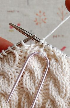 PurlBee Tutorial on cabling and a baby cabled vest.