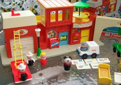 Fisher Price Village  I believe my parents may have regretted buying this toy because of the firehouse's siren. It was used all the time.