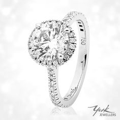 2.00cts of beauty surrounded by a fine diamond halo and diamond set band ❤️ Available now at York Jewellers