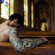 tattooed man. church pews. stained glass. perfection.