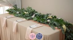 Greenery and flower table runner. Linen from The Table Cloth Hiring Company.