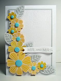#handmadewedding card ... mod look flowers and leaves stamped in mustard and gray ... luv the turquoise flower centers ... fussy cut and arranged in a spray ... subtle wood grain texture on main panel ... beautiful card!
