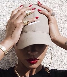 Red nails x red lips x gold hoops x baseball cap.