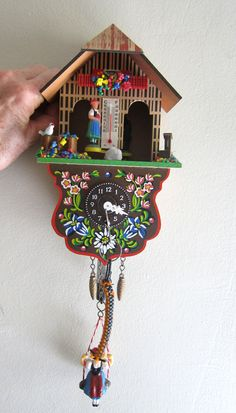 Vintage German kitsch cuckoo clock and weather house