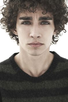 Robert Sheehan's curly hair gives him a mercurial flair (free rhyme on us)   Curly Hair Ideas For Guys