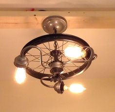 We created this bike rim chandelier from the rear wheel of an old bike. (13 diameter) It also includes various vintage light fixtures and lamp