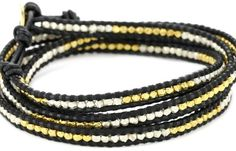 Create a look of complexity and texture with the Chan Luu Gold Vermeil And Silver Bead Black Leather Wrap Bracelet.
