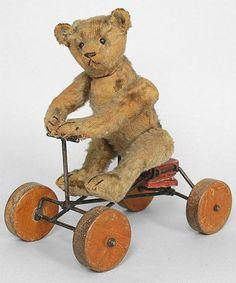 Bären Teddy Bear on Wheels. Steiff 1902 - 1919 Landscaping, An American Pass Time Article Body: La Old Teddy Bears, Steiff Teddy Bear, Antique Teddy Bears, Teddy Bear Toys, Antique Toys, Vintage Toys, Antique Decor, Doll Museum, Bear Doll