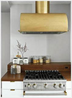 **Gorgeous brass hood!!!   @Camille Styles  photo by Matthew Williams.