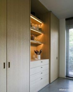 LOVE white oak joinery with strip lighting on open shelves. Also like handle detailing finished in same timber veneer