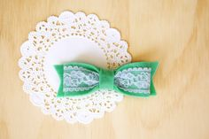 Felt Hair Bows {Great natural lighting and creative use of doily for a background!}