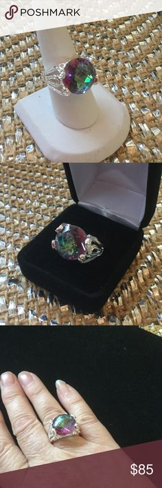 Majestic Moonlight Topaz Ring ! This lovely round princess cut genuine Mystic Topaz sits in an unusual .925 setting.  Very classy and Lux looking.  Artist styling in this unique setting gives it an Art Deco look.  Fit for a Queen approx. 15 ctw. Gem & Minerals Jewelry Rings
