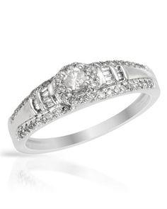 Genuine diamond and white gold ring.