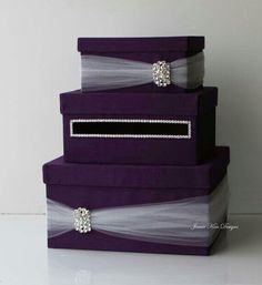 Pretty maybe in silver boxes with lavender tulle and flowers on top- Mary Myers