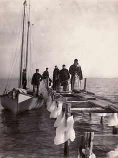 Mail boat arrives at North Manitou Island in 1903. The island is located in Lake Michigan, approximately 12 miles west-northwest of Leland, Michigan. It is nearly eight miles long and over four mil…
