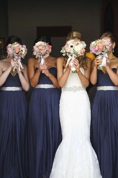 Bridesmaids in long navy dresses with silver belts @myweddingdotcom