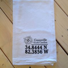 These custom, 100% cotton flour sack towels are hand printed with your city and state latitude and longitude.  www.163designs.com