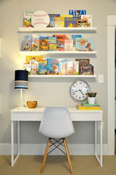 Kid Room Book Ledges, Ikea Besta Burs Desk, and White Eames Shell Chair. Great way to add color to a boy's or girl's room. All the white and color looks great on a gray wall!