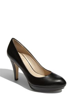 A good pair of black, leather pumps. This shoe can take you from the office, to church, to a night out with the girls, to a wedding, dinner date with your guy, etc.