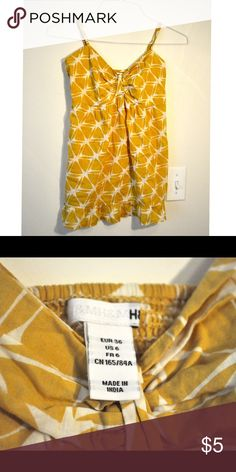 yellow print tank top HM yellow print tank top. Size 6 with adjustable straps. Goes well with jeans, shorts and skirts! excellent condition H&M Tops Tank Tops