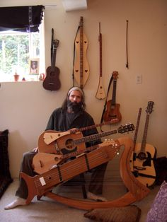 the omstrument: harp, guitar, longneck dulcimer, strumstick, and tanpura, also tenor ukulele, with Jack Haas